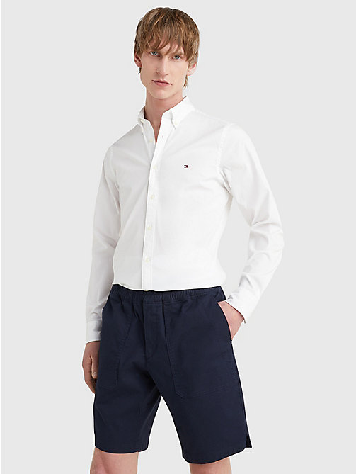 Camicia slim fit in cotone stretch - BRIGHT WHITE - TOMMY HILFIGER Uomini - immagine principale