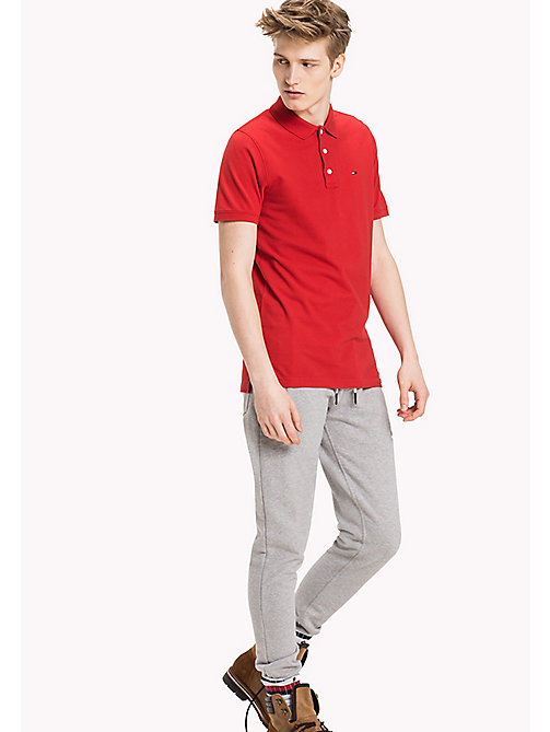 TOMMY JEANS Cotton Piqué Slim Fit Polo - SALSA - TOMMY JEANS Clothing - main image