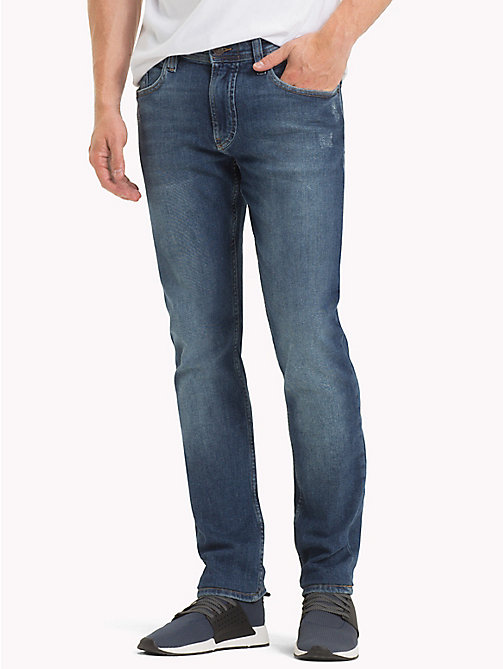 TOMMY JEANS Tapered Fit Jeans - ILLINOIS MID BLUE STRETCH DESTRUCTED - TOMMY JEANS Tapered Jeans - main image