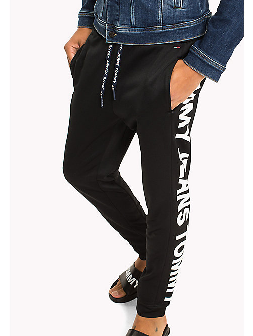 TOMMY JEANS Racer Logo Sweatpants - TOMMY BLACK - TOMMY JEANS Trousers & Shorts - main image