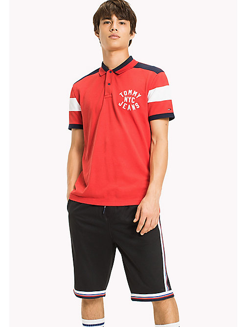 TOMMY JEANS Polo Relaxed Fit Shirt - RACING RED - TOMMY JEANS Sustainable Evolution - main image
