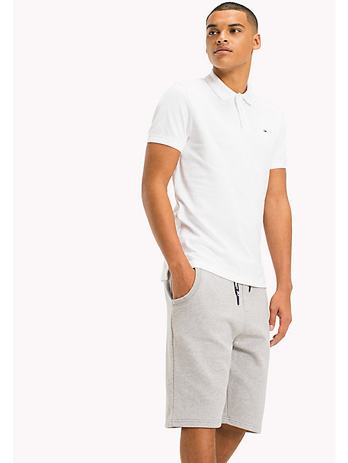 TOMMY JEANS Cotton Stretch Piqué Slim Fit Polo - CLASSIC WHITE - TOMMY JEANS MEN - main image