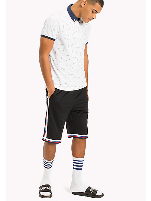 TOMMY JEANS Regular Fit Printed Polo - CLASSIC WHITE - TOMMY JEANS MEN - main image