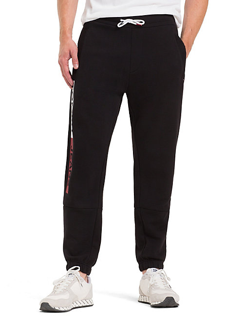 TOMMY JEANS Regular Fit Joggers - TOMMY BLACK - TOMMY JEANS Trousers & Shorts - main image