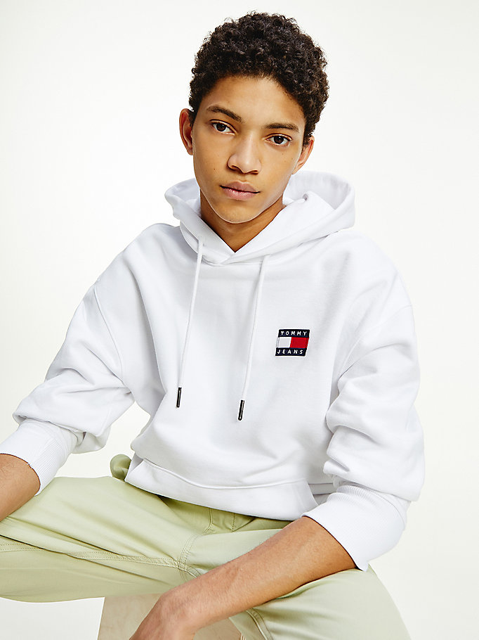 white tommy badge relaxed hoody for men tommy jeans