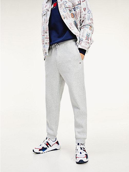 0ec566aab87c39 grey joggersy tommy classic o luźnym kroju dla mężczyźni - tommy jeans