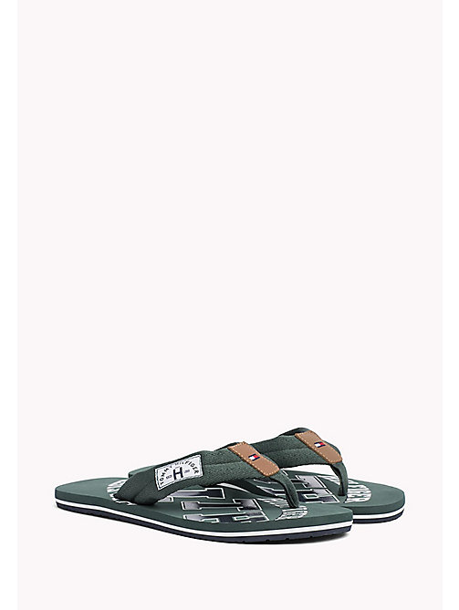 TOMMY HILFIGER Plażowe klapki Tommy - JUNGLE GREEN - TOMMY HILFIGER Sandals & Flip Flops - main image