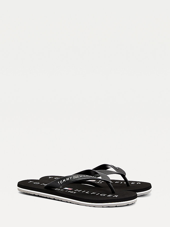 black 1985 logo print flip-flops for men tommy hilfiger