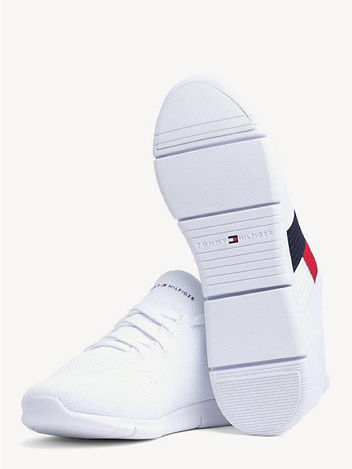 dce2803658e40 TOMMY HILFIGERLekkie dzianinowe buty sportowe z flagą. 399