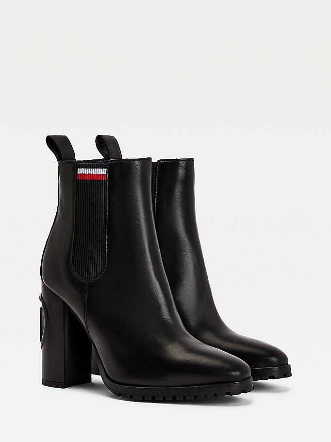 black monogram logo embossed heeled boots for women tommy hilfiger