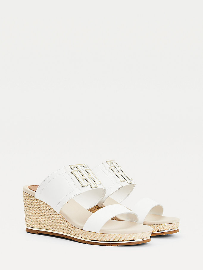 white monogram elastic wedge mules for women tommy hilfiger