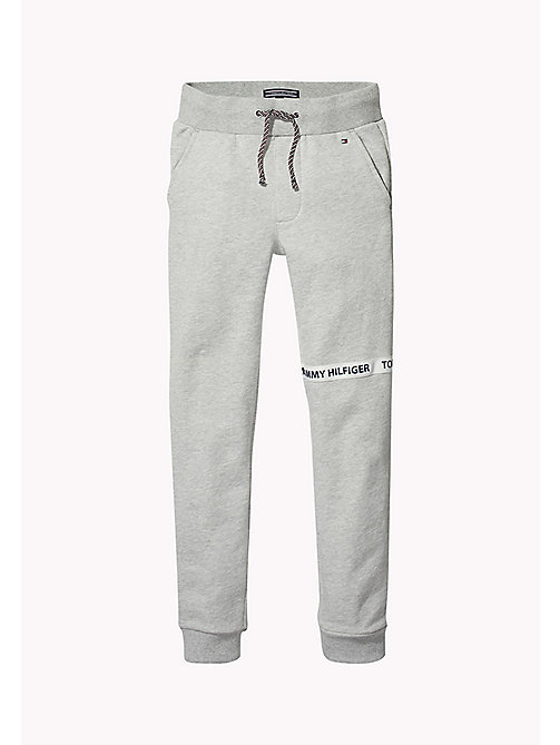 TOMMY HILFIGER Katoenen joggingbroek met logo-tape - LIGHT GREY HTR - TOMMY HILFIGER Broeken - main image