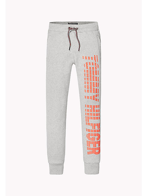 TOMMY HILFIGER Printed Cotton Terry Joggers - LIGHT GREY HTR - TOMMY HILFIGER Trousers, Shorts & Skirts - main image
