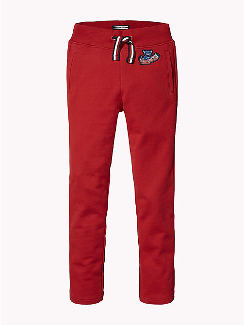 TOMMY HILFIGER UNISEX BADGE TAPERED SWEATPANTS - APPLE RED - TOMMY HILFIGER Trousers & Skirts - detail image 1