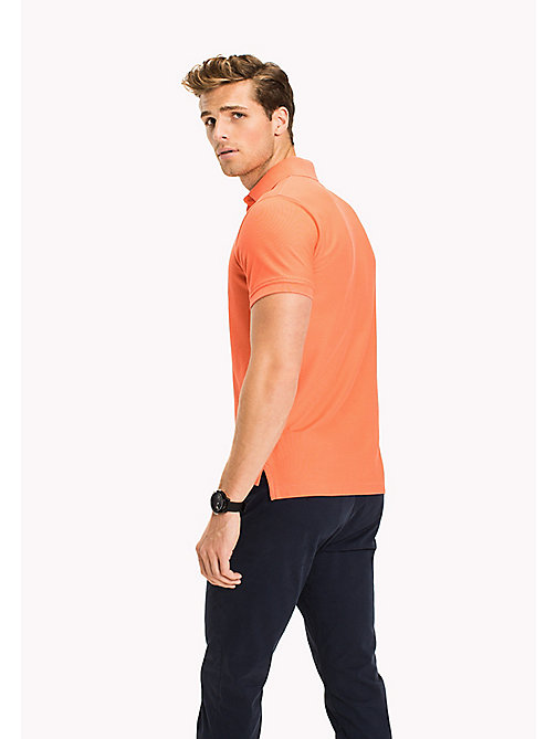 TOMMY HILFIGER Slim Fit-Polohemd aus Baumwolle - HOT CORAL - TOMMY HILFIGER Poloshirts - main image 1
