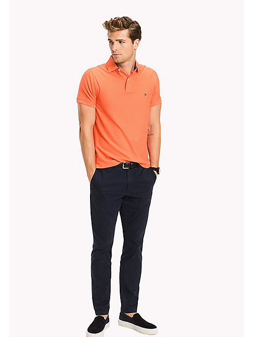 TOMMY HILFIGER Slim Fit-Polohemd aus Baumwolle - HOT CORAL - TOMMY HILFIGER Poloshirts - main image