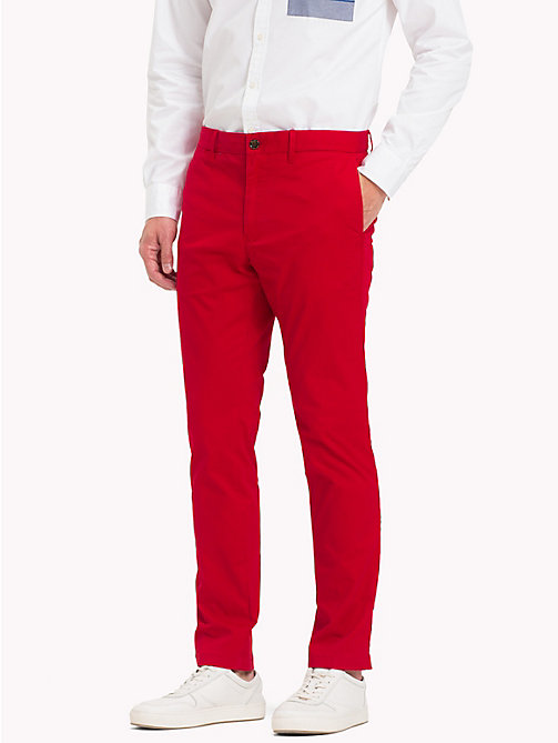 TOMMY HILFIGER Pantaloni chino slim fit in cotone biologico - HAUTE RED - TOMMY HILFIGER Sustainable Evolution - immagine principale
