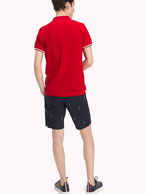 TOMMY HILFIGER Polo slim fit con bordi - HAUTE RED - TOMMY HILFIGER Polo - dettaglio immagine 1