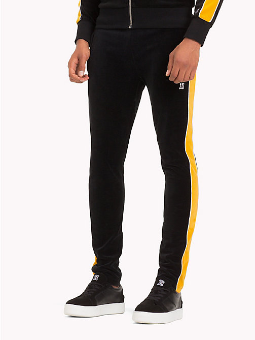 TOMMY HILFIGER Striped Velvet Tracksuit Bottoms - JET BLACK / GOLDEN YELLOW - TOMMY HILFIGER TOMMY NOW MEN - main image