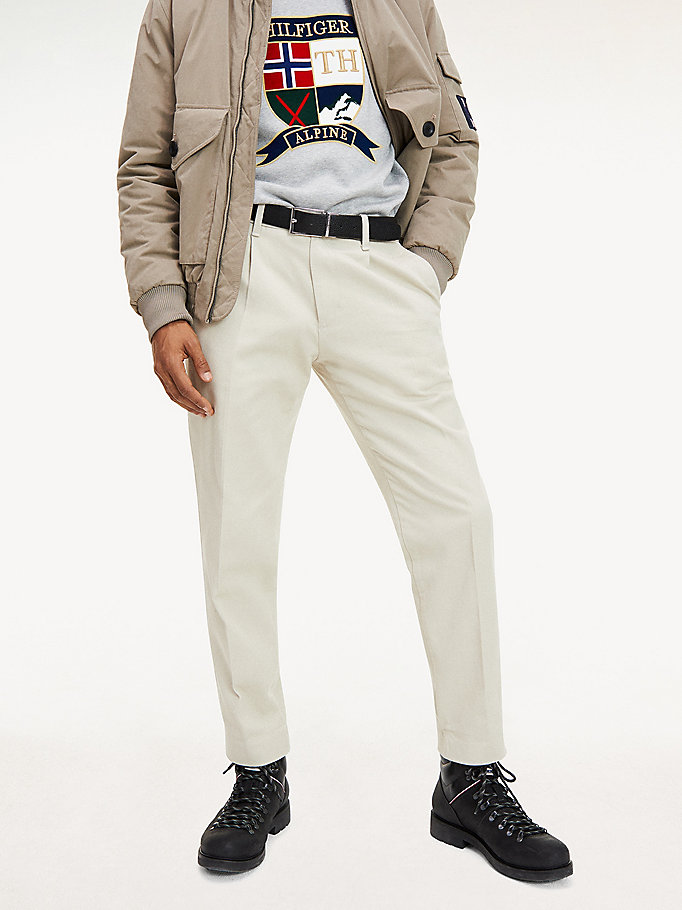 beige tapered fit pleated chinos for men tommy hilfiger