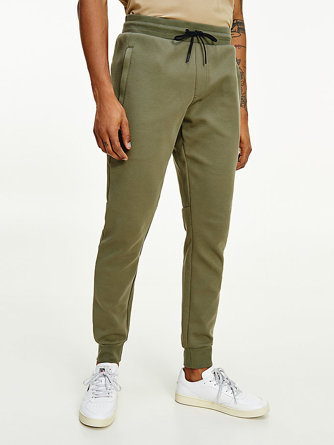 green essential drawstring waist tapered joggers for men tommy hilfiger