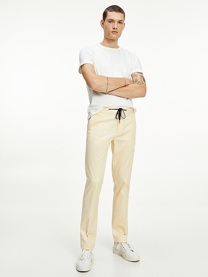 beige th flex drawstring waist trousers for men tommy hilfiger