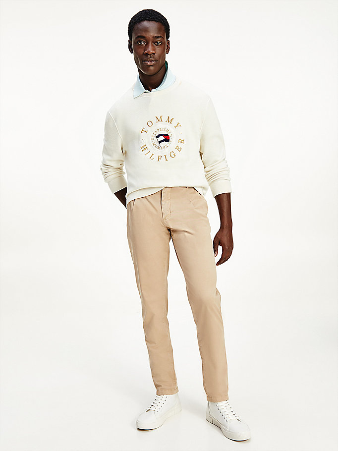 beige th flex tapered garment dyed trousers for men tommy hilfiger