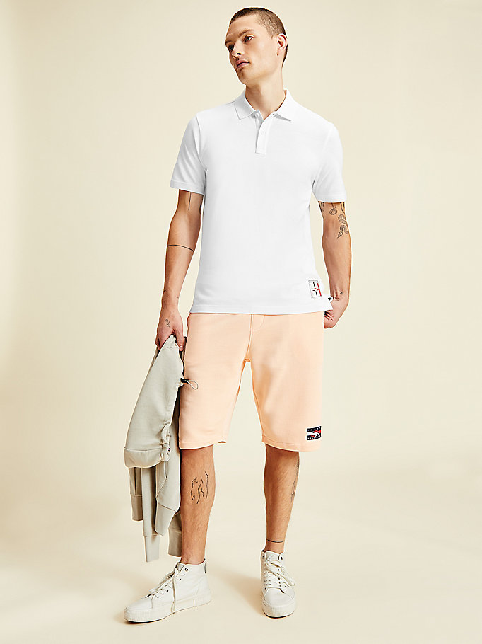 wit one planet polo met grafisch logo op de rug voor men - tommy hilfiger