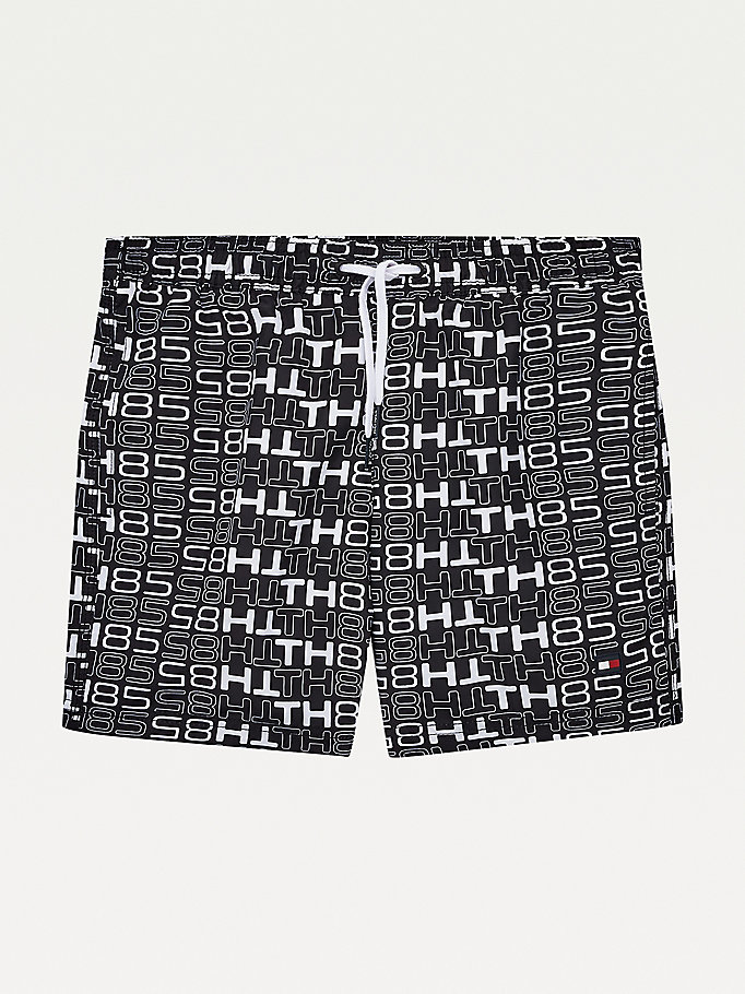 blue all-over logo print mid length swim shorts for boys tommy hilfiger