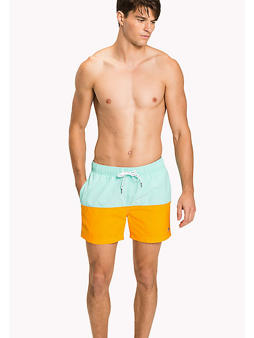 TOMMY HILFIGER Colour-Blocked Swim Shorts - ARUBA BLUE/BRIGHT MARIGOLD - TOMMY HILFIGER Swimwear - main image
