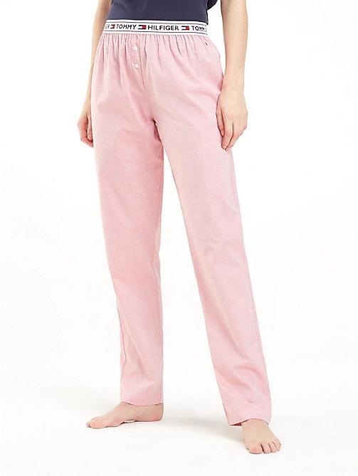 0b744418c3167b pink joggersy z tasiemką z logo w talii dla kobiety - tommy hilfiger