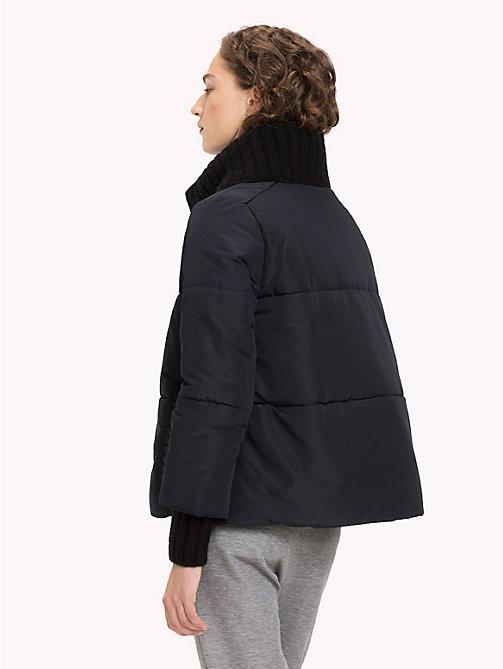 Пуховые куртки и комбинезоны унисекс